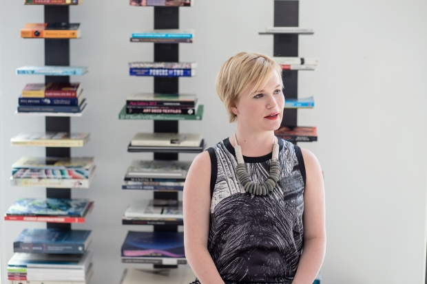 Laura talks inspiration in front of her shelf full of beautiful books